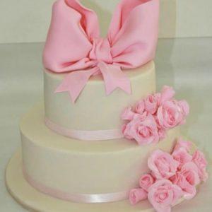 Ідеальний тортик з рожевим бантом і квітами