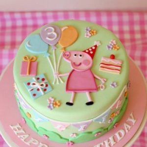 Тортик в зелених тонах прикрашений Свинкою Пеппа
