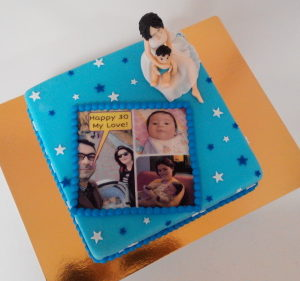 Торт у  с фигурками из мастики и фотоколажом