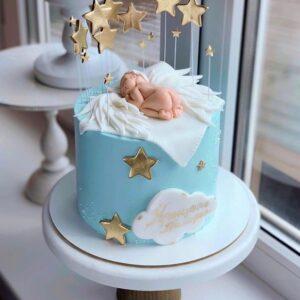 Торт з фігуркою сплячого немовляти