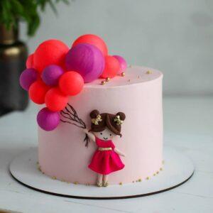 Торт дівчинка з кульками
