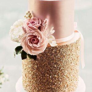 Весільний рожево-золотий торт зі стрічкою