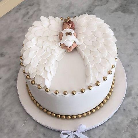 Торт на крестины с фигуркой младенца
